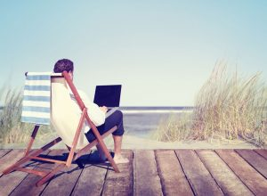 man-working-beach-vacation